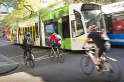 City tram with bicycles going past
