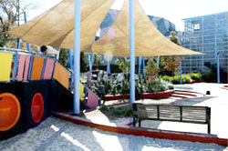 Playground with bench and sun shades.