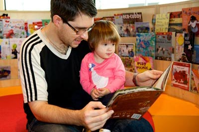 Man reading to a child