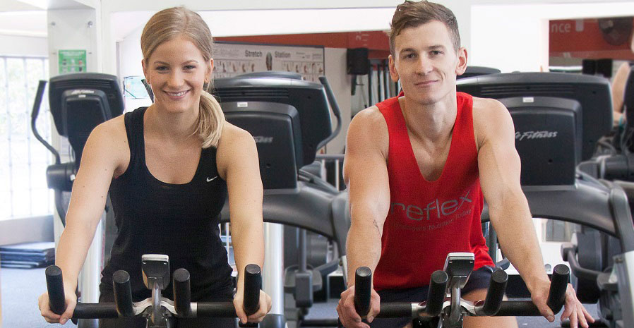 Man and woman using gym equipment