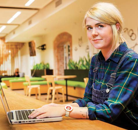 Girl at desk with laptop