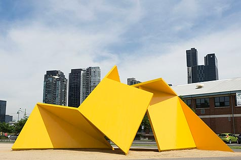 Yellow origami-like steel sculpture