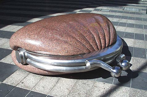 Red-granite and stainless-steel sculpture of purse