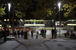 City tram stop at night